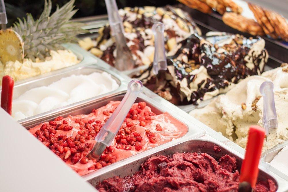 Ice creams over showcase closeup - © Apelavi /Shutterstock