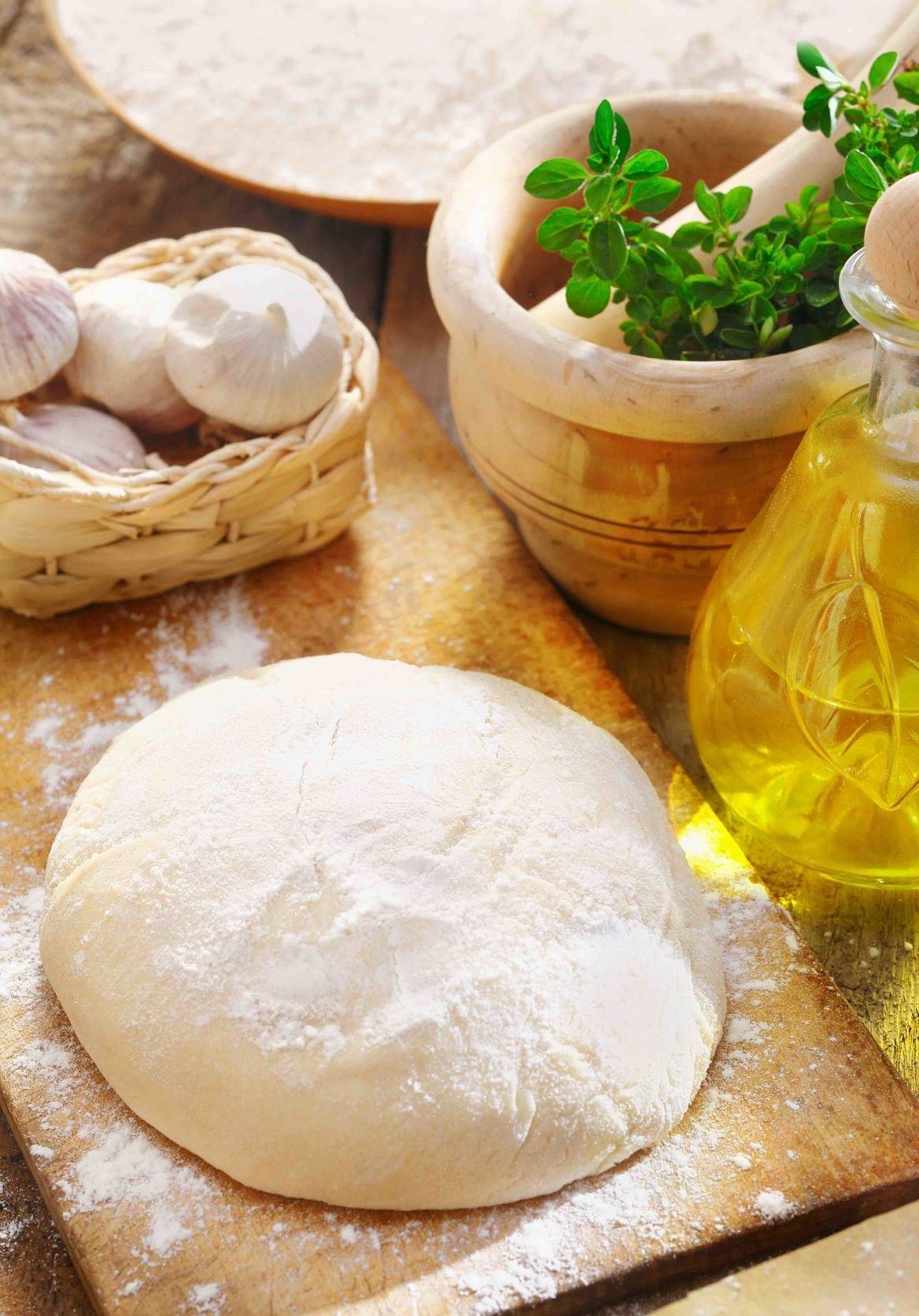 Une préparation de pâte à pizza ©stockcreations/Shutterstock
