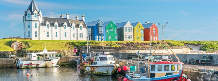 The colorful buildings of John O'Groats in a sunny afternoon, Caithness county, Scotland.; Shutterstock ID 673773235; ISBN: 9436511